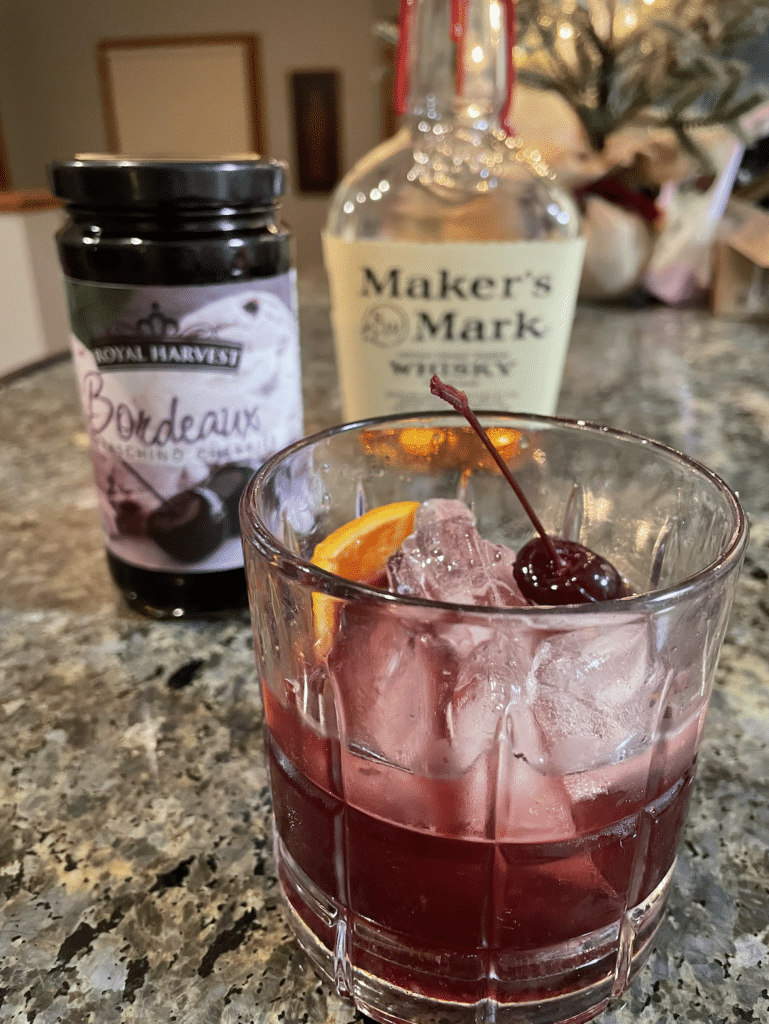 cherry whiskey cocktail on countertop recipe photo